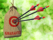Guarantee - Three Arrows Hit in Red Target on a Hanging Sack on Natural Bokeh Background.